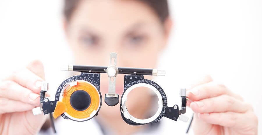 bigstock-Optometrist-holding-a-eye-test-33772922_1